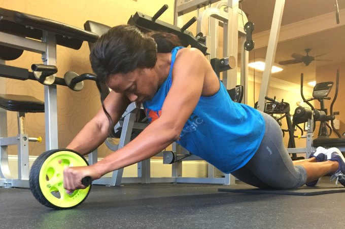 Keep your core tight as you roll out as far as you can go.